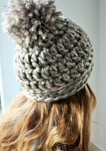 girl in chunky knit hat